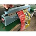 Cortador aluminio cuerpo mano impulso lateral selladora para envasado de alimentos