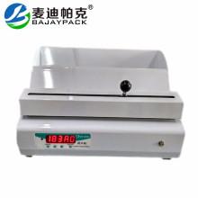 Máquina de sellado térmico para carrete de bolsa médica