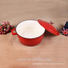 Red enamelware die cast pot