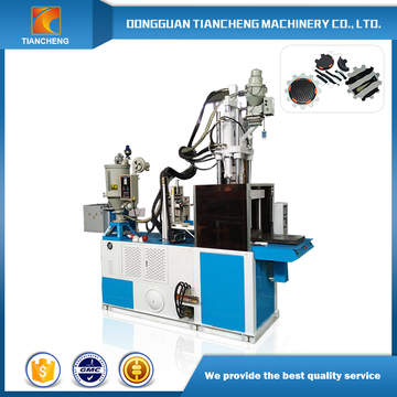 Single slide table vertical injection molding machine