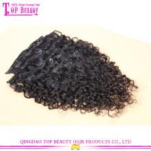 Qingdao top qualité lâche bouclés vierge malaysian clip dans les extensions de cheveux humains