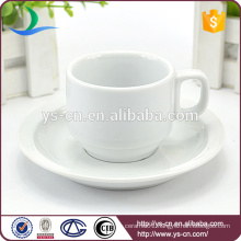 Modem white coffee cup and saucer holder