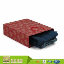 O logotipo feito sob encomenda do estilo clássico dourado do fornecedor imprimiu as calças de brim recicladas da roupa que empacotam ofícios do saco de papel para adultos