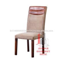 Cuero y lona de la vendimia que cenan la silla