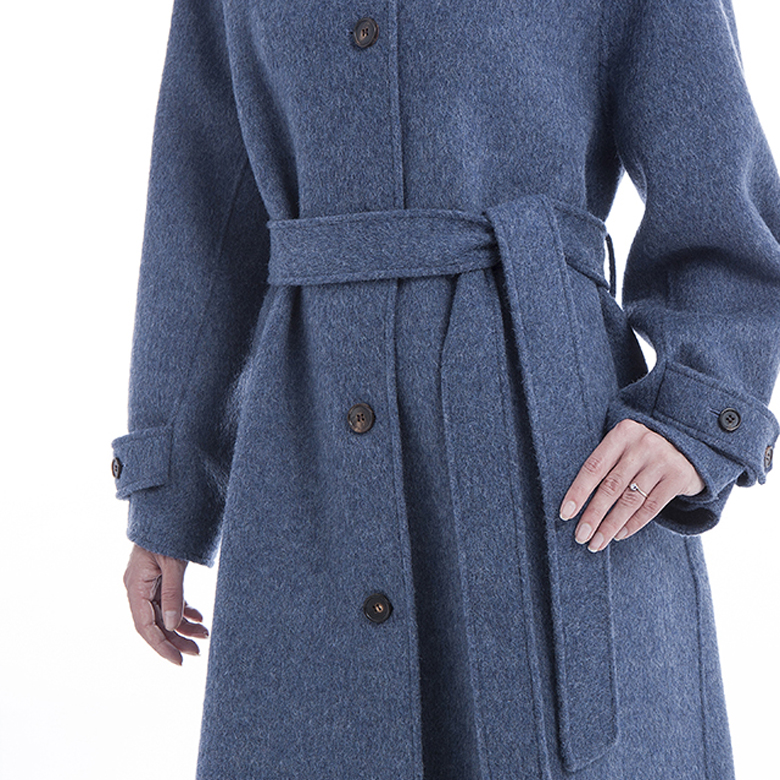 A belt with a single-breasted blue cashmere winter coat