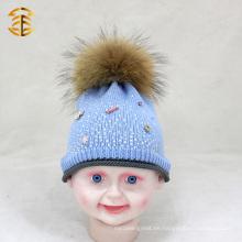 Precio de fábrica El más nuevo sombrero del invierno del bebé de la manera con la piel Pom Pom