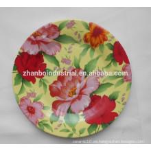Platos de cena redondos con la etiqueta de la flor