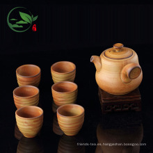 Juego de té de cerámica crudo hecho a mano que incluye una tetera de mango largo y 6 tazas de té marrón en una caja de regalo