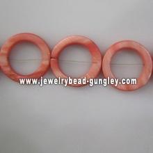 dark orange donut shape fresh water shell beads