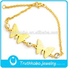 2015 tienda online moda dos mariposas de acero inoxidable 18K oro encantos brazalete cristales pulsera