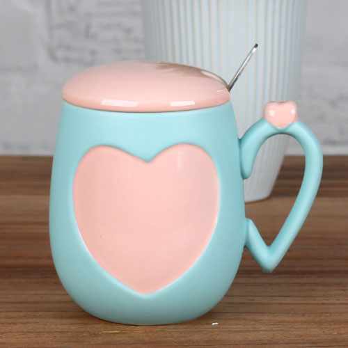 four leaf clover and heart coffee mug