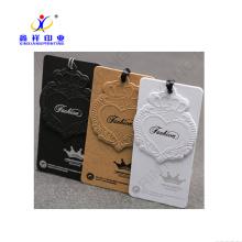 Étiquette faite sur commande de vêtement de coutume de couleur adaptée aux besoins du client, balise de coup de vêtements écologique ou adaptée aux besoins du client, étiquette volante de jeans