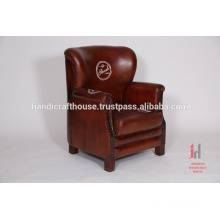 Antique dark brown leather butterfly sofa
