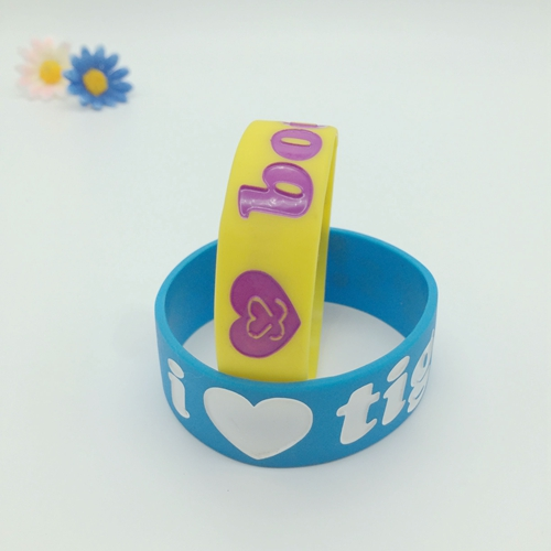 Debossed colored filled silicone wristbands