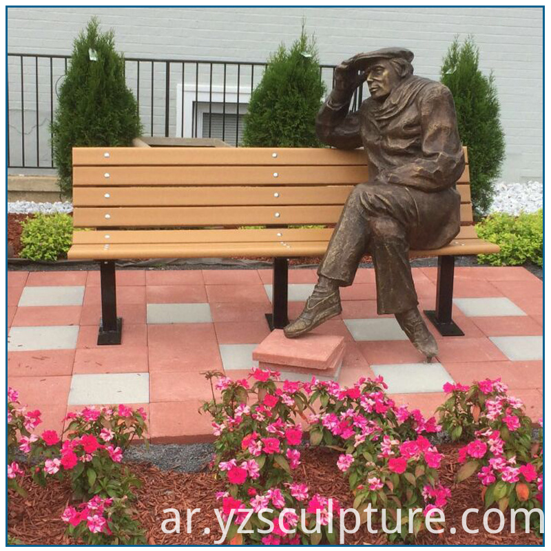 bronze sitting man sculpture