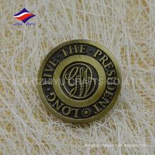 Emblema de ouro antigo do metal antigo da revolução americana