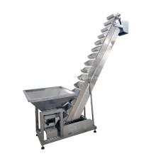 Наклонный ковшовый конвейер для гранул