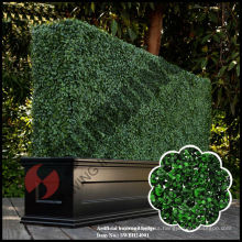Artificial topiary boxwood hedge with planter