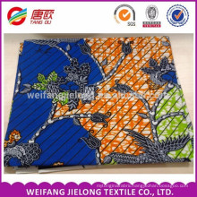 blue and orange colour with flower printing veritable wax block prints fabric