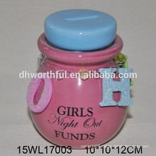 Ceramic pink coin bank with lid