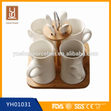 white ceramic coffee mug with spoon and wooden stand for gift