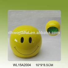 Amarillo cara sonriente en forma de titular esponja de cerámica