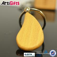 Le porte-clé en bois le plus chaud bon marché blanc fait sur commande de logo