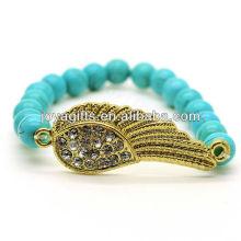Forme a turquesa los 8MM redondos rebordean la pulsera de la piedra preciosa del estiramiento con el ala de Diamante en el centro