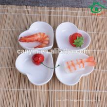 White, heart-shaped ceramic soy sauce dish