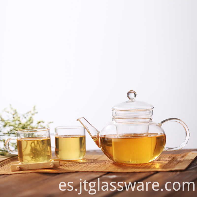 clear teapot and cups