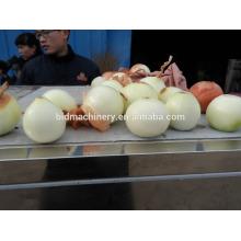 Automatic onion skin remover