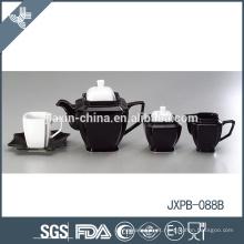 Elegante eco-friendly preto e branco copo de chá de cerâmica fina e pires conjuntos