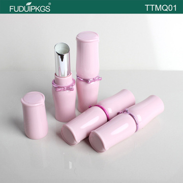 Pink empty lipstick tube with fancy butterfly