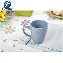 Tazas de cerámica coloridas impresas modificadas para requisitos particulares vendedoras calientes de las tazas de té con la manija