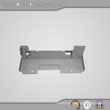 Componente de estampagem com pulverização em pó