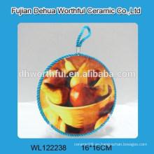 Sostenedores cerámicos del pote del trivet con los diseños de la fruta