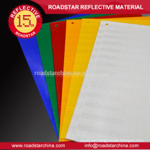 Commercial grade reflective sheeting for temporary warning signs