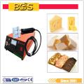 BDS tenu dans la main ultrasonique camembert alimentaire / fabic couteau de coupe cutter