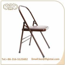 QTZD-001 vende al por mayor la silla plegable de la yoga del metal marrón