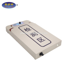 Cap/hat/scarf processing table needle detector