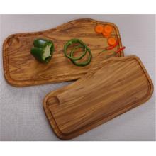 Tabla de cortar de madera de olivo con ranura y pozo