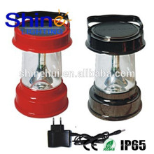 Garantía de comercio led solar linterna con cargador de teléfono móvil, luz de emergencia