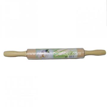 Wooden rolling pin with rotatable handle