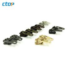 Wholesale YG brass spring lock sliders zipper puller zipper head custom jeans zipper slider