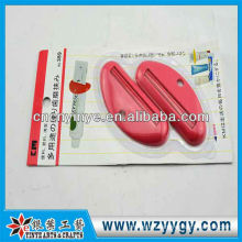 Popular custom plastic toothpaste squeezer device for promotion