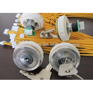 Interrupteur à clé de l'élévateur / bouton-poussoir