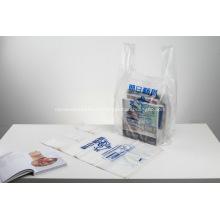 Zeitung mit Plastiktubenbeuteln