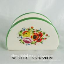 Suporte de guardanapo cerâmico de cor brilhante com decalque de flor