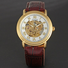 golden round alloy case with skeleton dial winner leather band watch