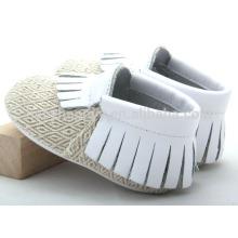 Los mocasines infantiles baratos vendedores calientes calzan los zapatos de bebé lindos de la lona